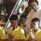Coach Ekkapol Janthawong, centre, and members of the rescued soccer team attend a Buddhist ceremony (AP/Sakchai Lalit)