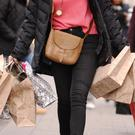 File photo dated 06/12/11 of a woman carrying shopping bags.