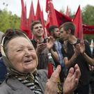 People in Moscow applaud a speech during a protest against raising the retirement age and reforming the pension system (Alexander Zemlianichenko/AP)