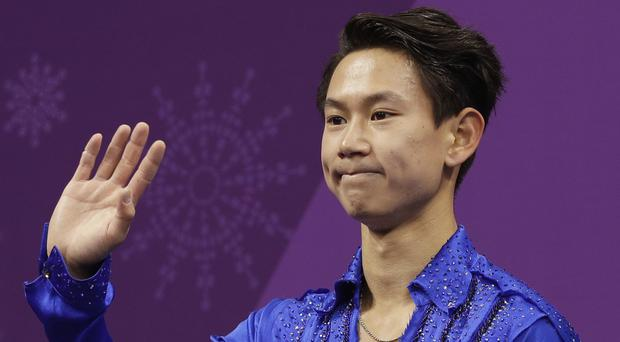 Suspect held over killing of Olympic figure skating star