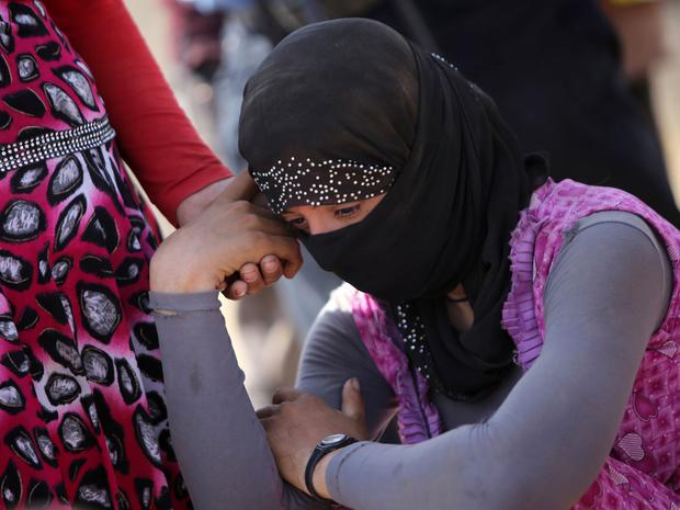 Pain: For the Yazidi women forced to abandon their children, the trauma of separation is compounded by the lingering stigma