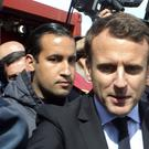 Emmanuel Macron is flanked by his bodyguard, Alexandre Benalla (Thibault Camus/AP)