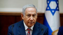 Israeli Prime Minister Benjamin Netanyahu said in a brief statement he had acted on the request of US President Donald Trump and other leaders. Photo: AP