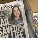 Copies of the New York Daily News on a news stand (AP)