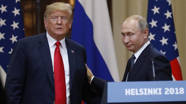 US President Donald Trump and Russian President Vladimir Putin after their meeting in Helsinki, Finland, in July (Alexander Zemlianichenko/AP)