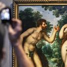 Visitors look at the painting Adam And Eve by Flemish master Peter Paul Rubens at the Rubenshouse in Antwerp (Olivier Matthys/AP)