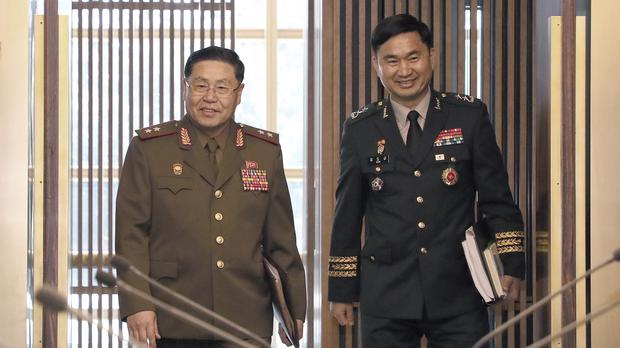 North Korean Lt Gen An Ik San, left, and his South Korean counterpart Maj Gen Kim Do-gyun (AP)