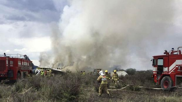 The airliner crashed in a field near the airport of Durango, Mexico (Civil Defence Office of Durango Photo via AP)