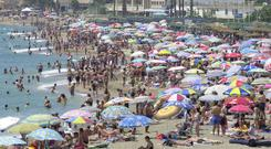 Spanish sunseekers are being warned to stay indoors during the hottest time of the day (Stefan Rousseau/PA)