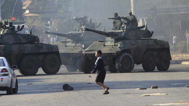 Military tanks patrol in Harare following demonstrations by opposition party supporters (Tsvangirayi Mukwazhi/AP)