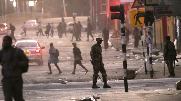 Police patrol as opposition MDC party supporters protest (AP)