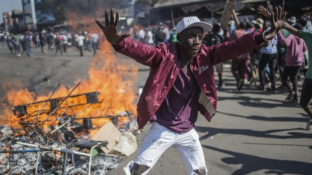 Opposition MDC party supporters protest in the streets of Harare (AP Photo/Mujahid Safodien)