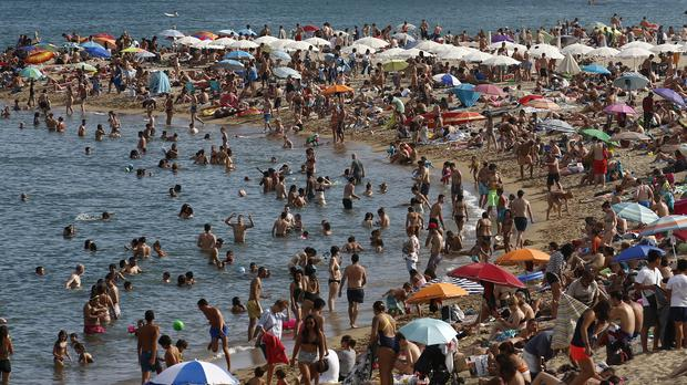 Spain and Portugal are both facing a heatwave (Manu Fernandez/AP)