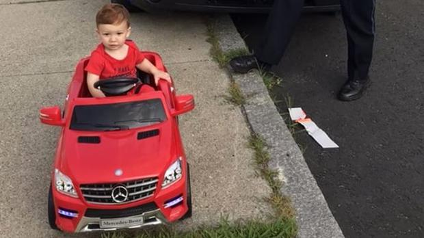 One-year-old Grayson Salerno is pulled over for driving without a licence but got off with a 'cuteness warning' (Cori-Devan Salerno/AP)