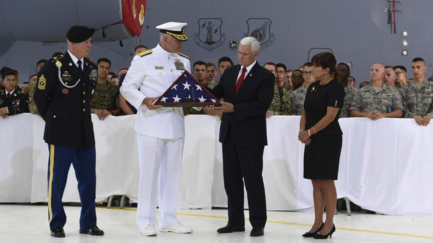 The remains were returned to the US on Wednesday (Susan Walsh/AP)