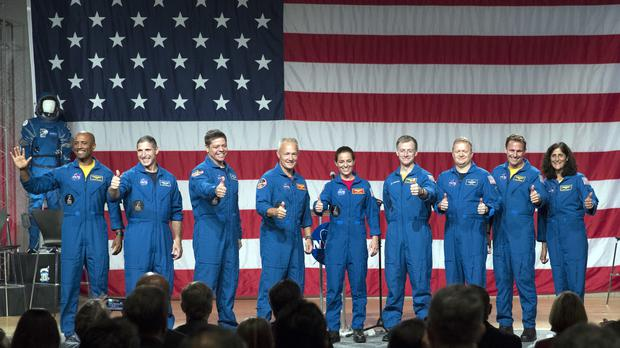 Astronauts, from left to right, Victor Glover, Michael Hopkins, Robert Behnken, Douglas Hurley, Nicole Mann, Christopher Ferguson, Eric Boe, Josh Cassada and Sunita Williams give a thumbs up to the crowd after Nasa announced them as astronauts assigned to crew the first flight tests and missions of the Boeing CST-100 Starliner and SpaceX Crew Dragon, (David J. Phillip/AP)