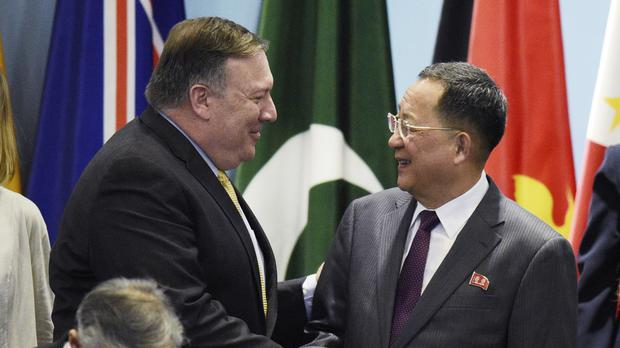 US Secretary of State Mike Pompeo, left, greets North Korea's foreign minister Ri Yong-Ho (Joseph Nair/AP)