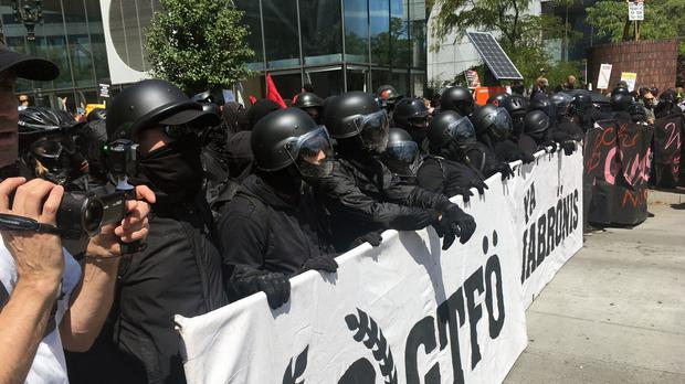 Protesters line up in Portland (AP Photo/Manuel Valdes)