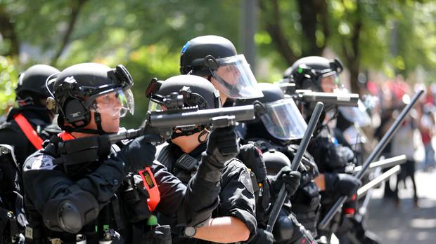 A review of police force will be carried out after the clashes (Mark Graves /The Oregonian via AP)