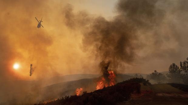 It is the second year in a row that California has recorded the state's largest wildfire (Josh Edelson/AP)