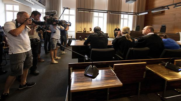 Photographers take pictures of the a man and a woman in the court in Freiburg before sentencing (Patrick Seeger/DPA/AP)