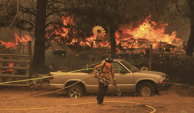 A total of 14,000 firefighters are battling blazes across California (Kent Porter/The Press Democrat via AP)