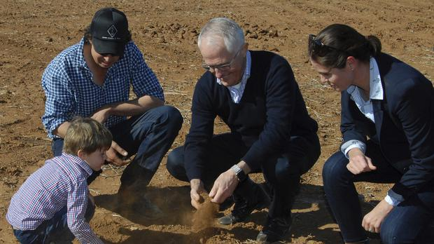 Australia's Prime Minister Malcolm Turnbull, centre right, has unveiled a package of measures to assist farmers (Ivan McDonnell/AAP Image via AP)