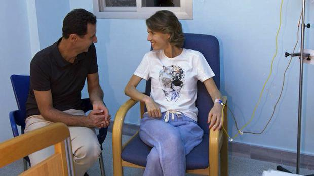 Asma Assad is understood to be in a military hospital in Damascus (Facebook page of the Syrian Presidency via AP)