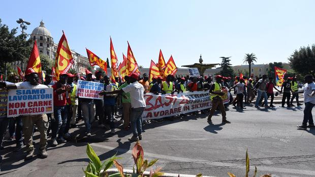 African migrant workers stage a march (Franco Cautillo/ANSA via AP)