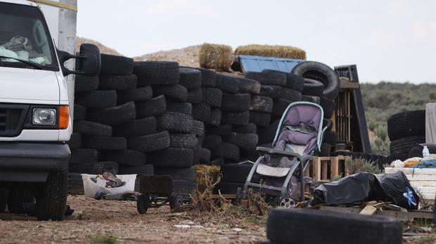 A filthy makeshift compound in rural northern New Mexico (Jesse Moya/The Taos News/AP)