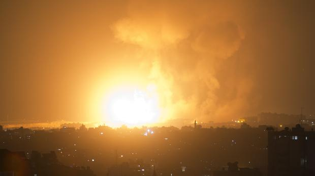 An explosion caused by Israeli airstrikes on Gaza City (Khalil Hamra/AP)