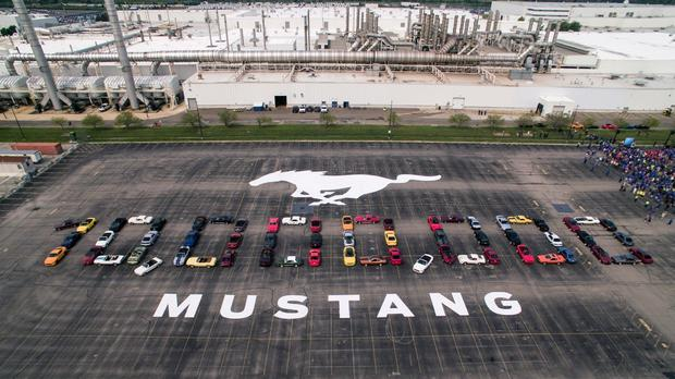 Mustang vehicles are parked to spell out 10,000,000 (Ford/AP)