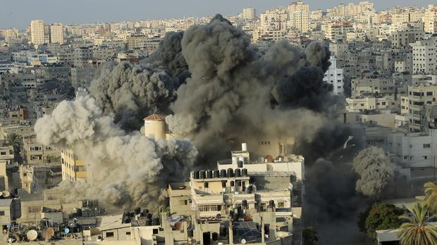Smoke rises from an explosion caused by an Israeli airstrike in Gaza City (Arafat Kareem/AP)