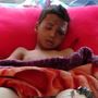 An injured survivor of Thursday's airstrike on a bus carrying children in northern Yemen. Photo: AP