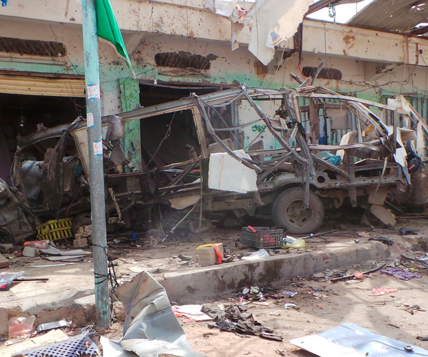 The wreckage of a bus at the site of an airstrike in Saada, Yemen. Photo: AP