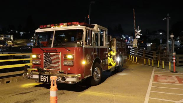 Fire engines drive towards a ferry boat headed to Ketron Island at the ferry terminal in Steilacoom, Washington (Ted S Warren/AP)