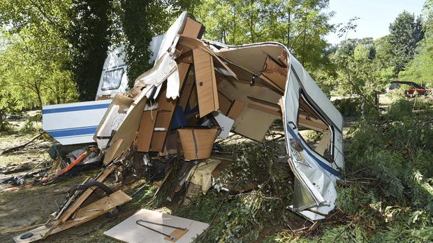 A damaged trailer after floods in a campsite in Saint-Julien de Peyrolas, France (Jose Roca/French Gendarmerie National via AP)