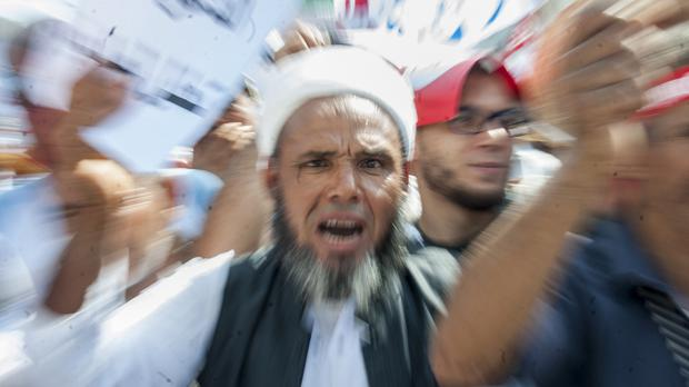 A man shouts during a demonstration in Tunis (AP Photo/Hassene Dridi)