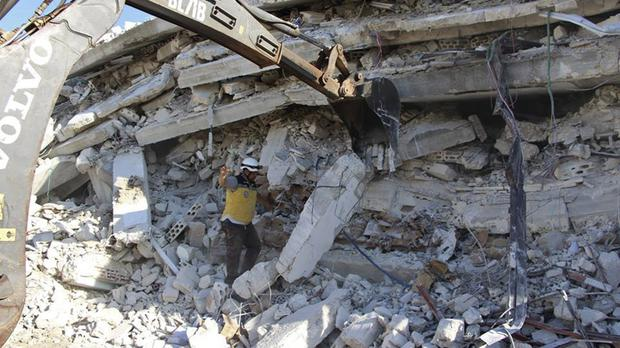 The explosion brought down a five-storey building (Syrian Civil Defence White Helmets via AP)