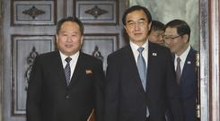 South Korean Unification Minister Cho Myoung-gyon, right, and his North Korean counterpart Ri Son Gwon arrive for their meeting at the northern side of Panmunjom in the Demilitarised Zone, North Korea (South Korea Unification Ministry/AP)