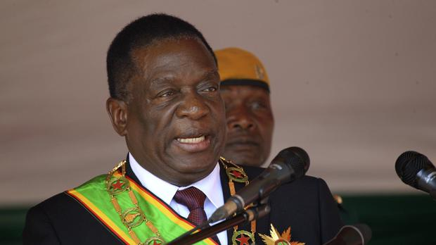 Zimbabwean President Emmerson Mnangagwa addresses people during a Heroes' Day event (AP)