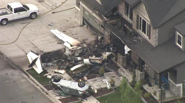 The scene of a small plane that crashed into a house in Payson, Utah (John Wilson/KSL-TV/Deseret News via AP)