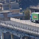 A truck perched at the very edge of the Morandi Bridge (AP)