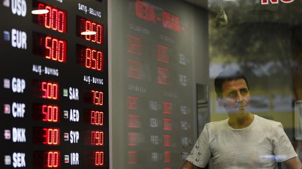 Turkey's finance chief has pledged to fix the country's economic troubles (Lefteris Pitarakis/AP)