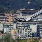 A view of the collapsed Morandi highway bridge in Genoa yesterday. Excavators have begun clearing large sections of the collapsed highway bridge in the search for people still missing three days after the deadly accident. Photo: AP
