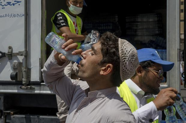 A pilgrim drinks water near the Grand Mosque (Dar Yasin/AP)