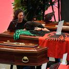 Women mourn over a coffin with the Albanian flag draped over it ahead of a state funeral for one of the victims in Genoa, Italy. (Luca Zennaro/ANSA via AP)