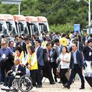 South Koreans leave for North Korea to take part in family reunions (Korea Pool/Yonhap via AP)