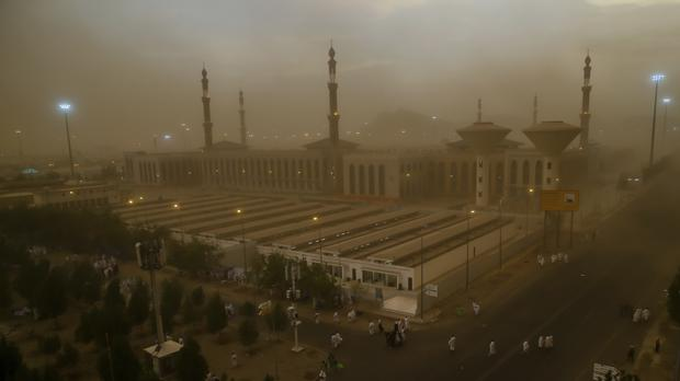 A sand storm engulfs Muslim pilgrims as they arrive at Namirah Mosque on Arafat Mountain (Dar Yasin/AP)