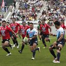 Yamaha Jubilo's Kira Tomokazu carry the ball during a memorial rugby match against Kamaishi Seawaves at Kamaishi Recovery Memorial Stadium (Koji Ueda/AP)